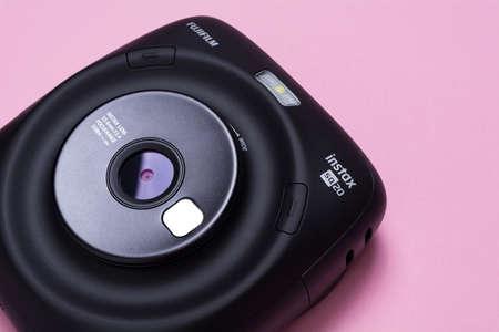 Kyiv, Ukraine - 25 May 2020: Fujifilm Instax Sq 20 Black on apink background Редакционное