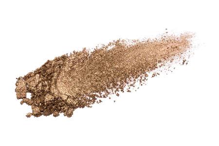 Eyeshadow sample isolated on white background. Crushed brown metallic eyeshadow. Closeup of a makeup product. 版權商用圖片
