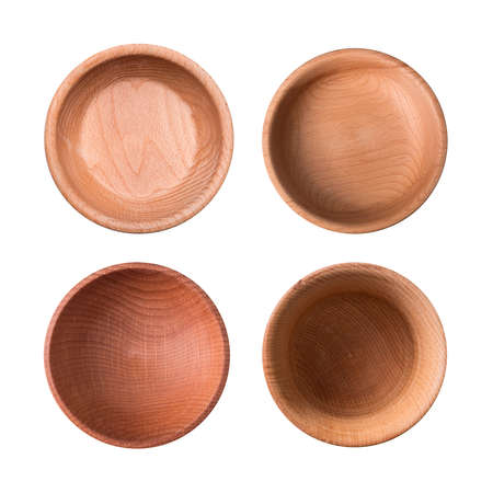 Set of wooden plates isolated on white background. View from above Фото со стока