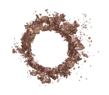 Eyeshadow sample isolated on white background. Crushed brown metallic eyeshadow. Closeup of a makeup product. Round frame Фото со стока