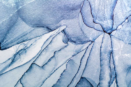 Luxury fluid art painting background. Spilled blue and silver acrylic paint. Alcohol ink splash.