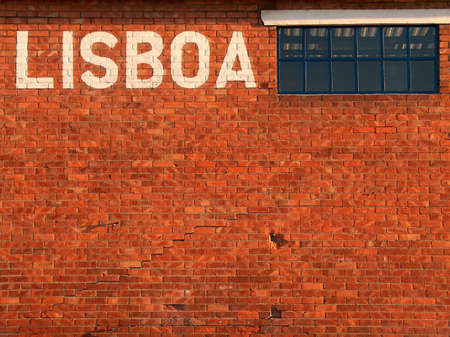 Wall from a warehouse in Alcantara docks, at Lisbon, Portugal. photo