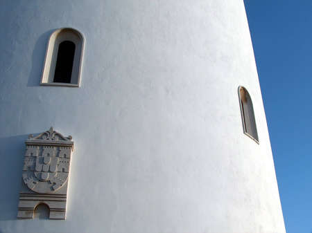 Details of a Portuguese water tower, in the city of Moura, Alentejo (south of Portugal). The Portuguese coat of arms can be seen in the bottom left corner.