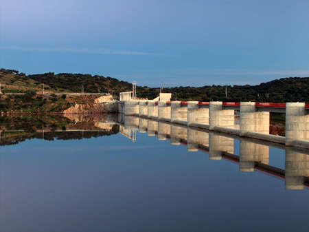 After the construction of Alqueva dam was finished another one was built a few miles down the river, near the town of Pedrógão, creating a very long and beautiful water mirror. Stock Photo