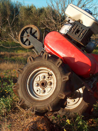 The two-wheel tractor, also known as power tiller, is a versatile machine that can be used to work the soil and perform general purpose tasks. photo