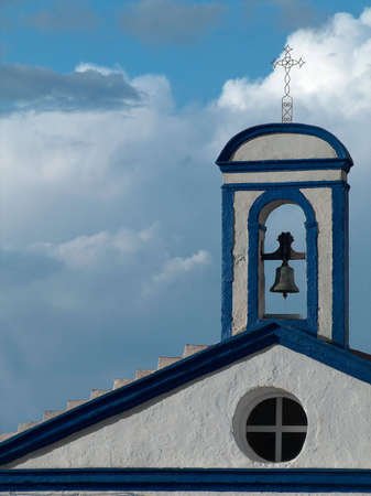 Small chapel, built in the 17th century, devoted to Our Lady of Remedies (Nossa Senhora dos Remedios). It is located in Serpa, south of Portugal, and it is painted with the traditional colors of this region, white and blue. Stock Photo - 2597357