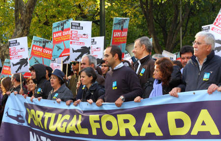 LISBON - NOVEMBER 20: Members of the Portuguese Parliamentary Group of the Left Bloc participate in the protests against NATO, on the last day of NATO Summit, November 20, 2010. Stock Photo - 8300756