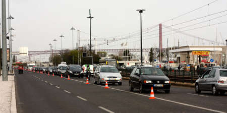LISBON, PORTUGAL - MARCH 24: Cars line up as a result of traffic restrictions put in place for WRC Rally of Portugal, on March 24 2011, at India avenue in Lisbon, Portugal. Stock Photo - 10484503