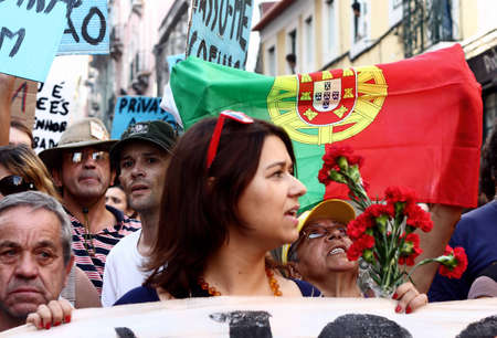 LISBON, PORTUGAL - OCTOBER 15: Protesters participating on the global Occupy protests march towards the parliament, on October 15 2011, at Lisbon, Portugal.
