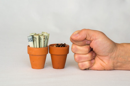 punched: Money in terracotta pot being punched