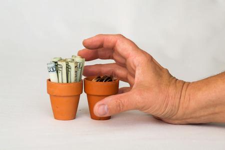 terracotta: Money in terracotta pot being grabbed