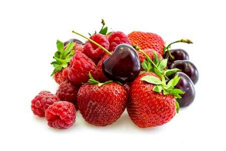 a few pieces of fresh red fruits - strawberries, raspberries, cherries Stock Photo - 9832561