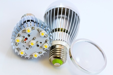 two LED light bulbs with 1 Watts SMD chips one of them  without cover glass photo