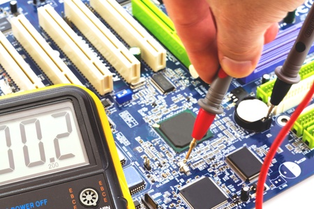 basic measuring and testing the motherboard to the PC by measuring instrument Stock Photo - 13175756