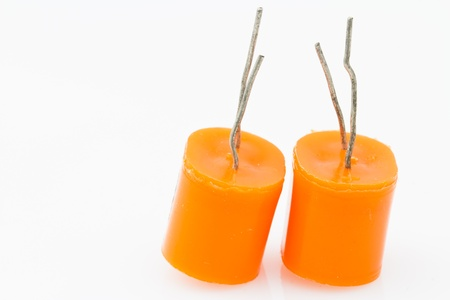 electrolytic: two orange electrolytic capacitor for mounting to printed circuit boards