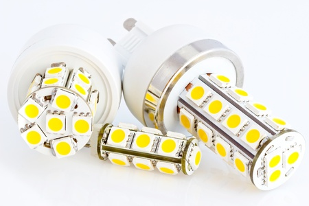 two LED bulbs G9 and one LED bulb G4 with 3-chip SMD LEDs Stock Photo - 13175658