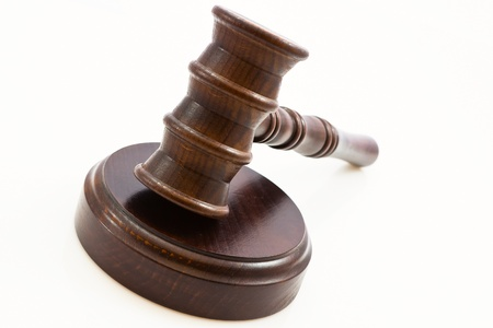 wooden judge gavel and wooden stand on a white background Stock Photo - 13175724