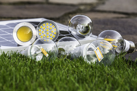 E27 tungsten, halogen and various LED bulbs on the grass; GU10 on solar panel