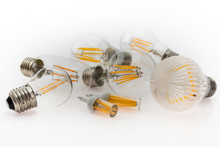 a performance different types of E27 and G4 LED bulbs with different number of LED filaments, focusing on the bulb in the foreground Stock Photo