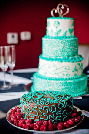 Beautifully decorated cakes bathed in window light.
