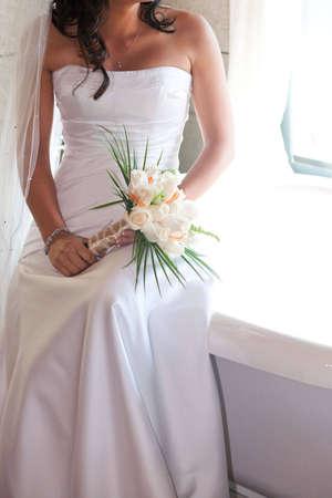Bride in Window Light Imagens