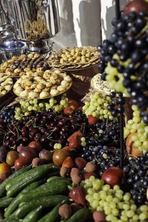 Fruits, Vegetables and Pastries spread on a large table
