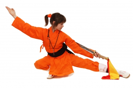 gung: The girl wushu in orange costume in low guard Stock Photo