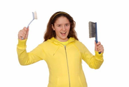 charlady: Merry girl holds the scrubbing  brushes
