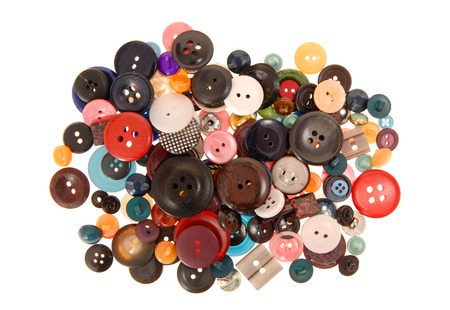 Plastik: Many-coloured buttons are on white background