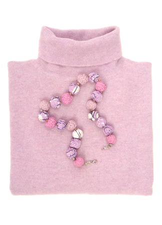 A textile necklace is on wool sweater  Stock Photo