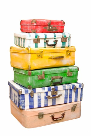 Heap of many-colored suitcases is on white background
