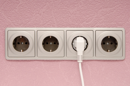 Grey wall outlet are on  is on lilac wall