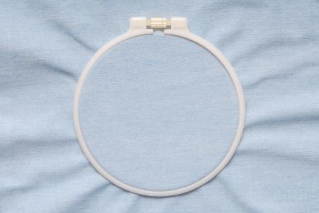 A plastic tambour is on blue denim