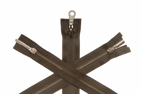 Three metal zippers are on white background