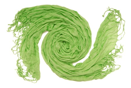 The green scarf is in spiral shape