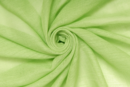 It is a close-up of  green textile
