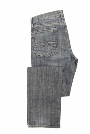 Folded blue jeans are on white background