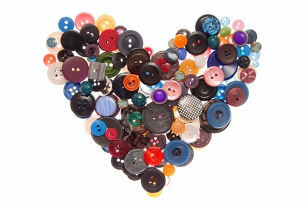 A heart is out of variegated plastic buttons  photo