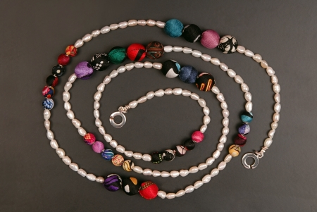 seed beads: A pearl necklace is on black background