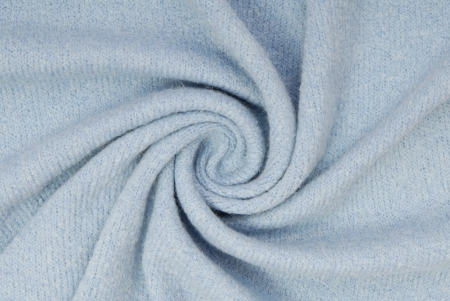 Blue knitted fabric is in spiral shape  photo