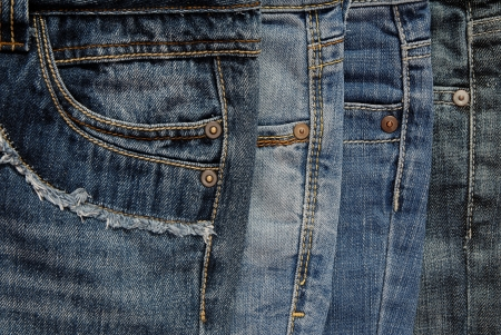It is a close up of pile of jeans  photo