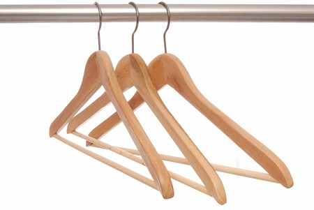 Empty wooden hangers are on white background