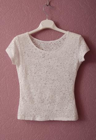 Transparent white blouse is on hanger