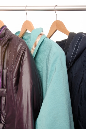 warm things: Jackets are on hangers  Stock Photo
