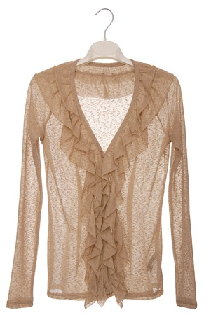 jabot: It is a beige blouse with jabot