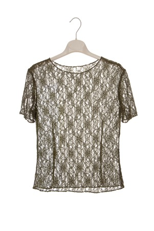 A guipure blouse is on clothes-hanger  photo