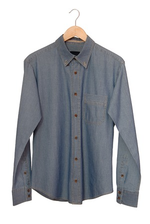 A blue denim shirt is on clothes-hanger  photo