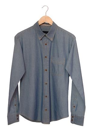 A blue denim shirt is on clothes-hanger