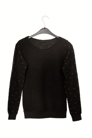 pull over: It is a black sweater with golden decor  Stock Photo
