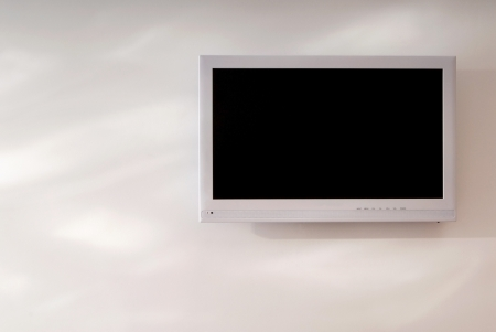 white television set is on wall Stock Photo